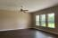 Family Room with tall e-glass windows. *Photo of previous home. Colors & Options may vary.