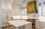 Kitchen featuring Custom Cabinetry and Marble Countertops - 1st Floor