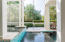 Transition from the porch and step off into your moat of a pool and leisure the day away.