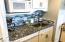 All newer appliances in fresh white/custom backsplash.