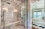 Luxurious dual head shower off from largest of the three master suites.