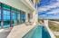 Beautiful gleaming pool that is enhanced by the beautiful travertine pool deck.