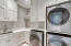 Large Laundry room is located on first floor. Washer and two dryers and so much storage!