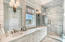 Luxurious spa bath off king suite in Carriage House. Quartz double vanity