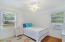 Spacious bedrooms with original parquet flooring and ceiling fans!
