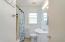Updated fixtures in the bathroom with original tile flooring
