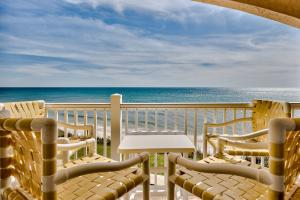 Gulf Front Balcony off the living area with private steps to beach