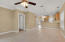 Tall ceilings, fans, crown molding and tile floors.
