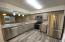 New Countertop, Cabinets, appliances, fixtures, sink disposal, lighting and more!
