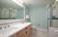 Double vanity sink, updated tile floors and cool contemporary colors in master en suite bathroom.