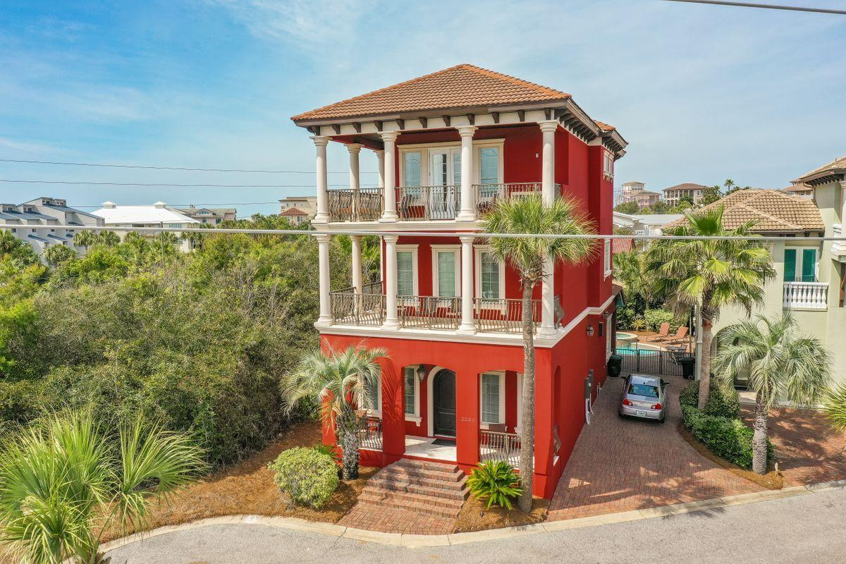 Iconic red Italian villa in Palmeira Villas of Blue Mountain is located directly across from the his