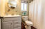 Full Bath with Plank Style Tile flooring, updated vanity and Bead Board Ceiling