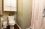 Separate Water Closet Area with Shower with additional storage cabinet