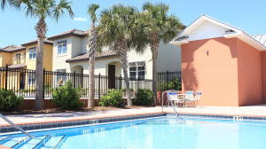 Townhome is literally right next door to the beautiful community pool. So pretty look at night and day!