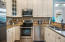 Kitchen with granite countertops and stainless appliances.