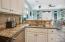 Kitchen with beautiful custom backsplash.