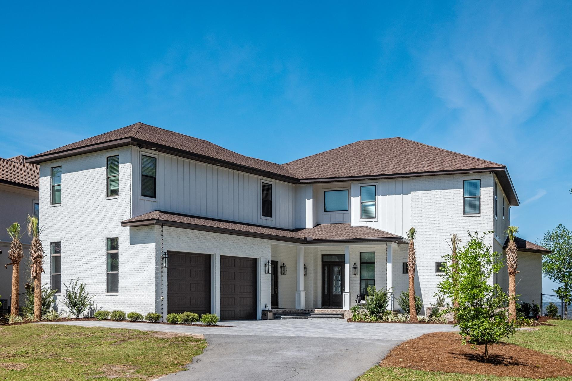 Stunning Bayfront Estate! This truly is estate living, featuring 2 waterfront lots with 200' waterfr