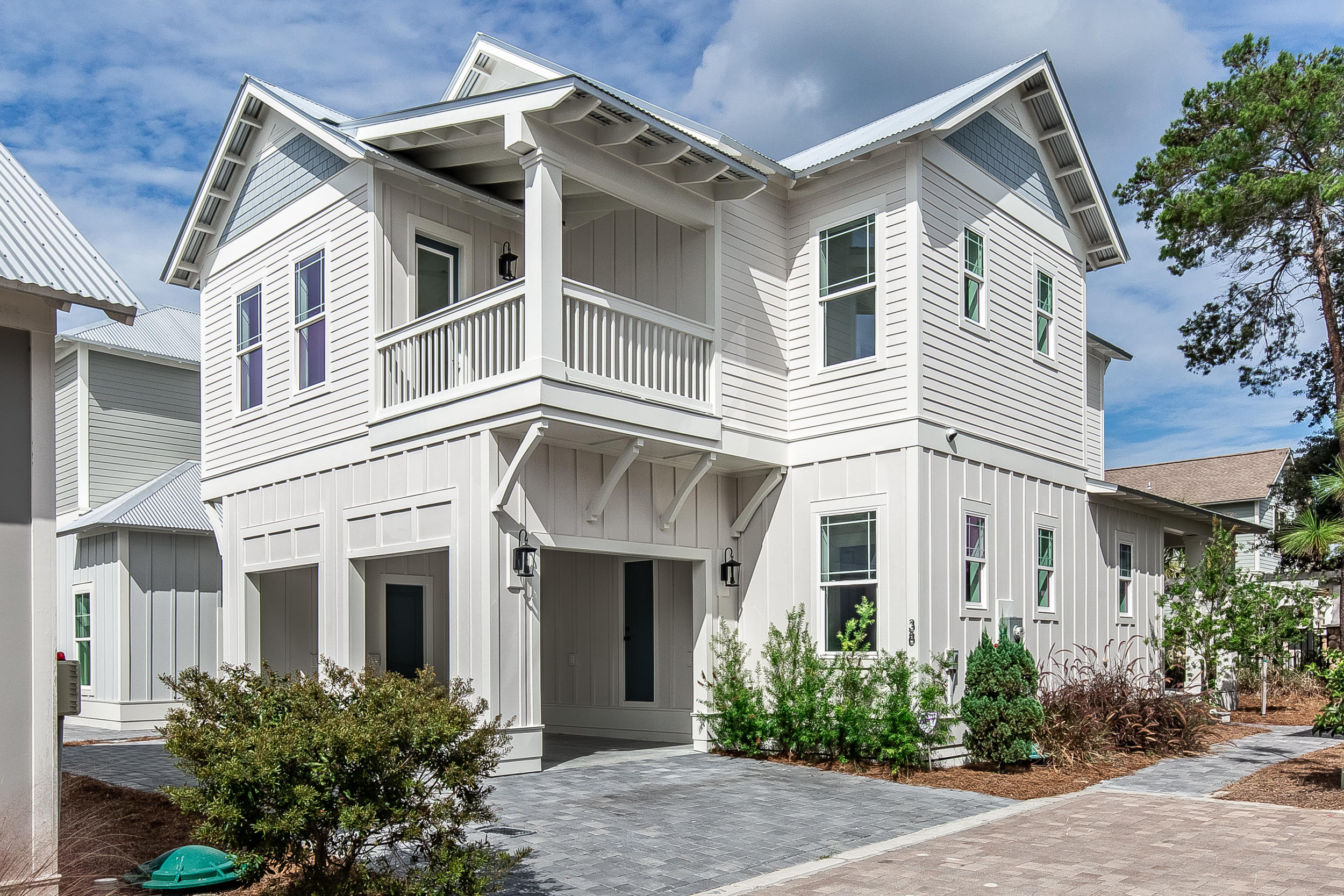 Introducing the Hammock Oaks plan. The first floor consists of a large open living and dining room,