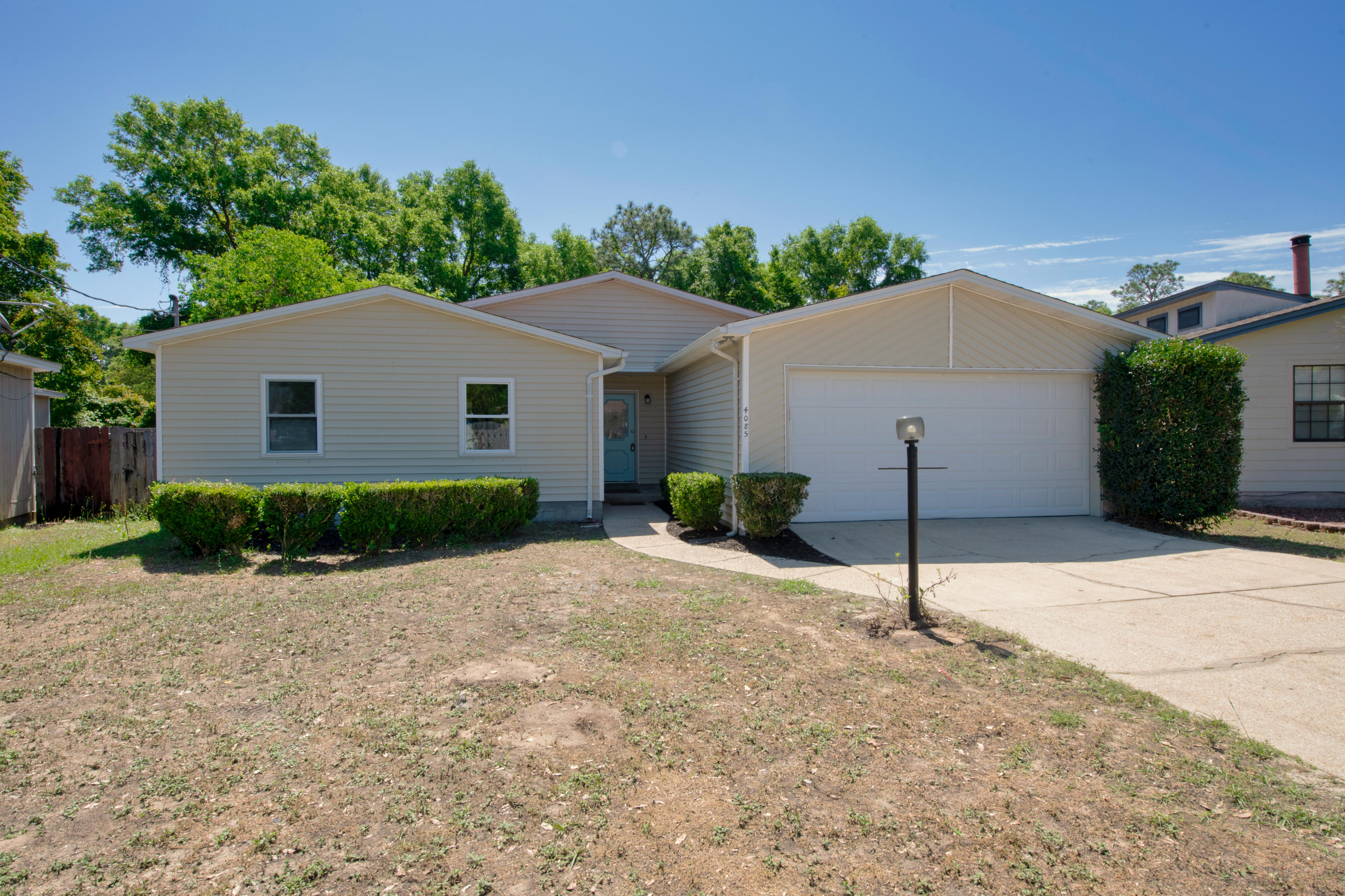 Renovated 3 Bed 2 Home in Pensacola with large yard! The kitchen features NEW White Shaker Cabinets,