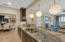 Gorgeous Chandeliers and Blue Louise quartzite throughout the kitchen.