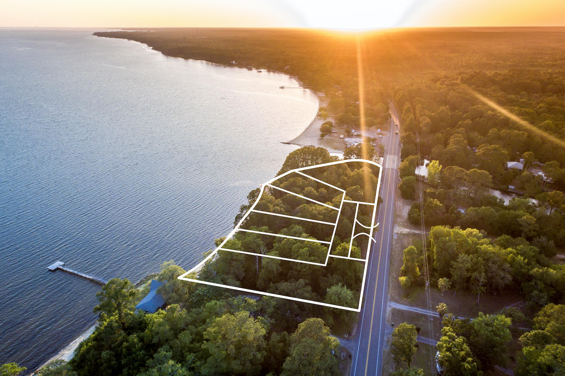 CALLING ALL BUILDERS!  Prime opportunity for an exclusive waterfront community on Walton County's fast growing North Shore.    Walton County development order just approved for six lots with little infrastructure needed.  These six lots face south with glorious views of both the sunrise and sunset over Choctawhatchee Bay.   If you are a builder on the Emerald Coast, this is a great investment opportunity with plenty of profit potential.  Call now for more information!