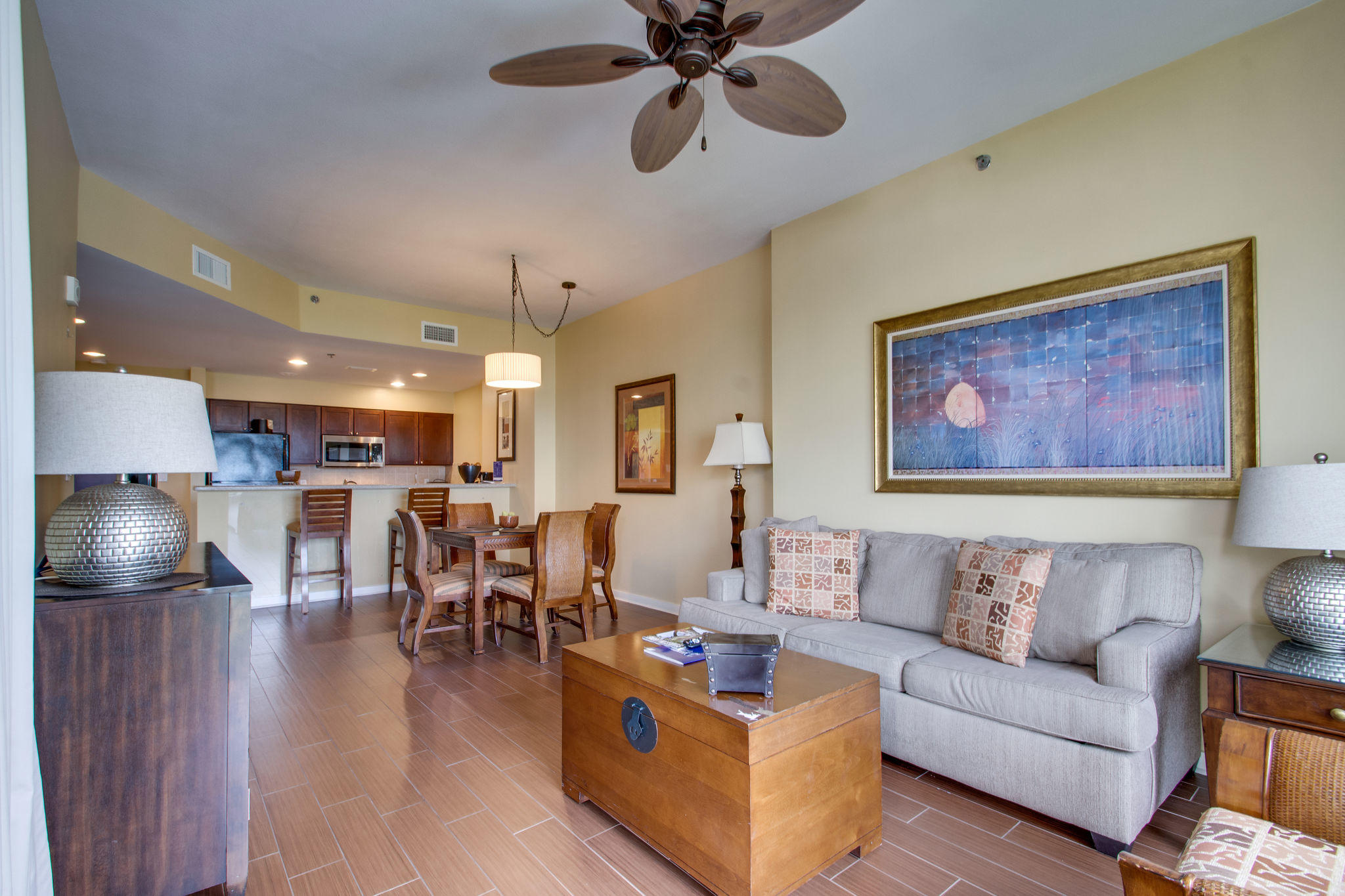 Fully furnished and rental-ready 4th-floor condo with sunrise Gulf views. Steps away from Luau's lag