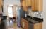 Kitchen features granite counter tops
