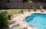 Brick pavers surround the pool