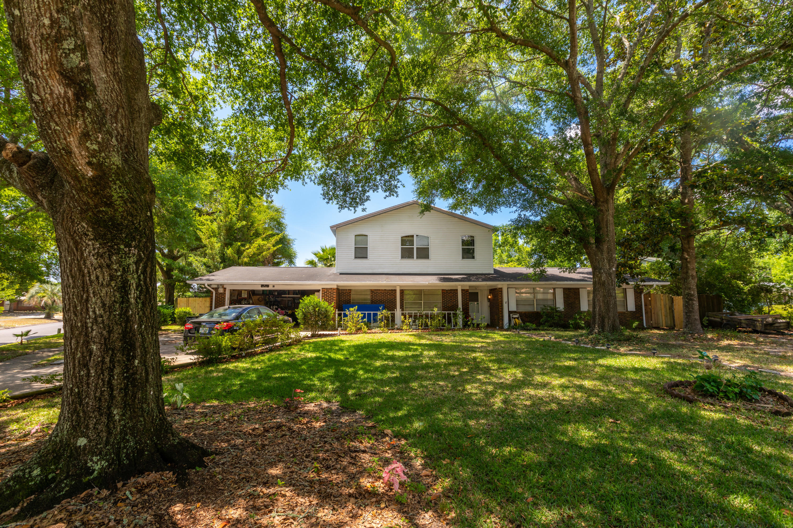 This family friendly 4 bedroom, 3 full bath, pool home sits on a level corner lot in the heart of th