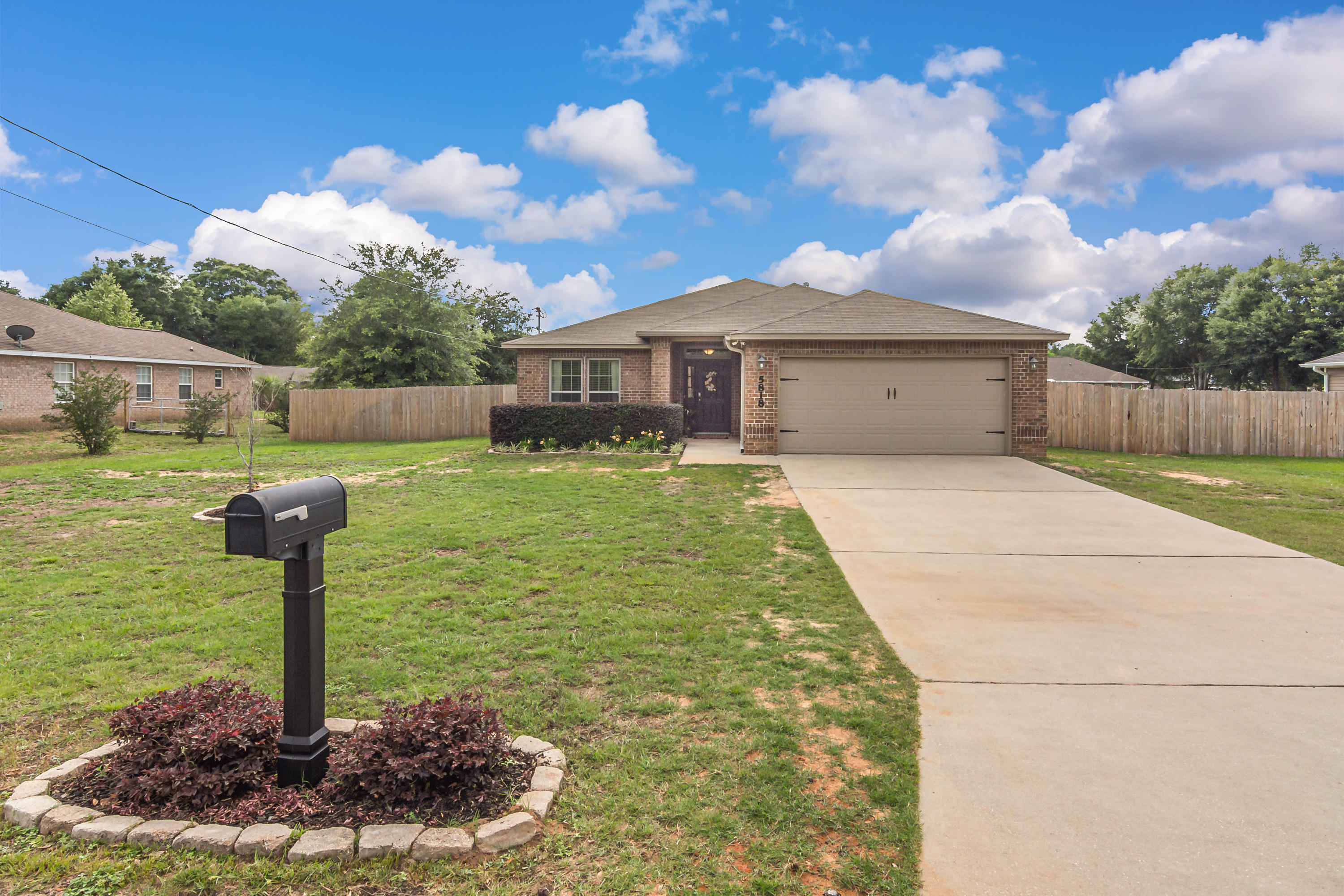 MOVE-IN READY!! Beautiful and well kept 3 bd/2 ba all brick home situated on over 1/3 acre and locat