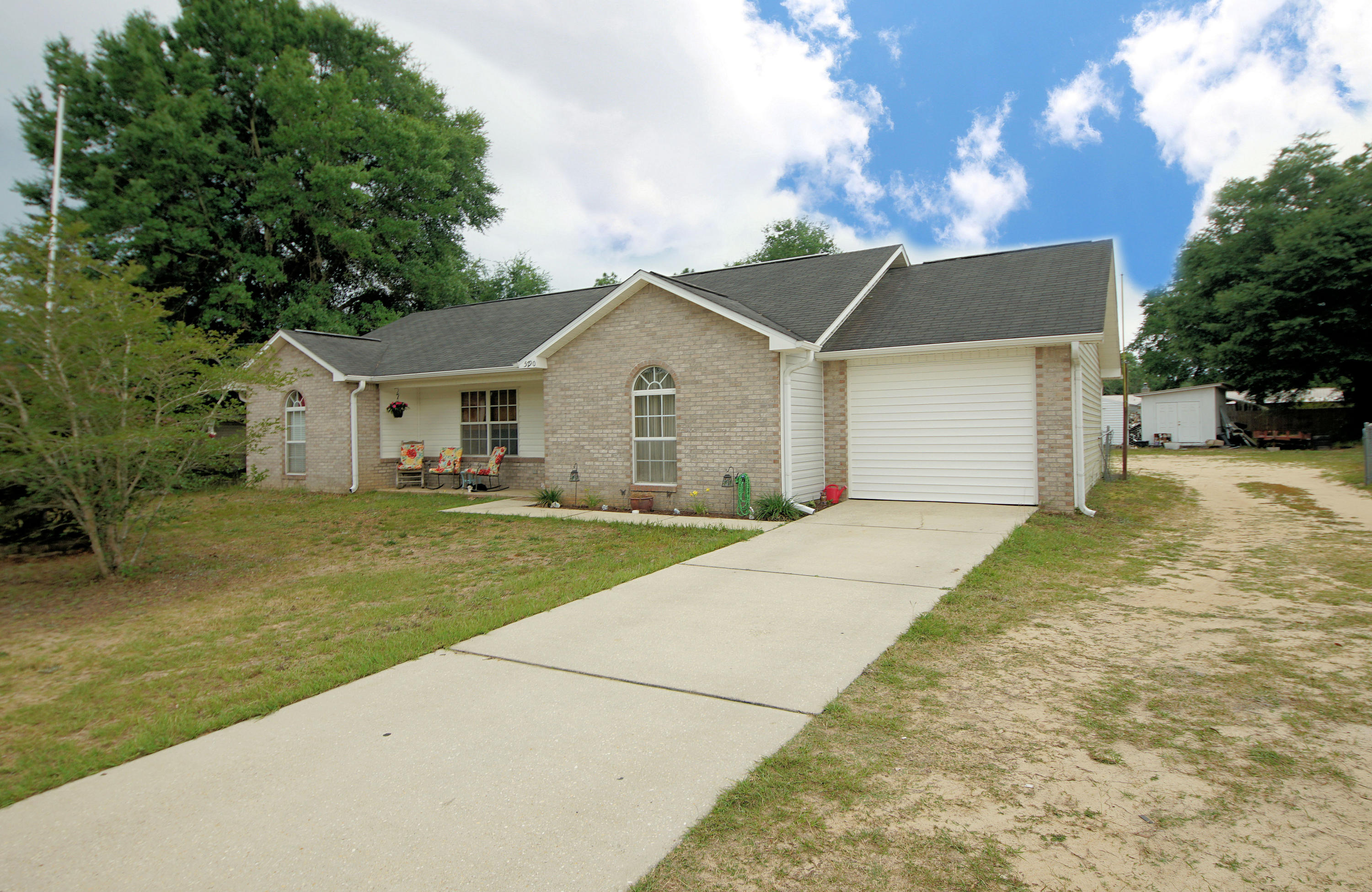 The quiet life! This charming home is situated in north Crestview sits on just under an acre of land