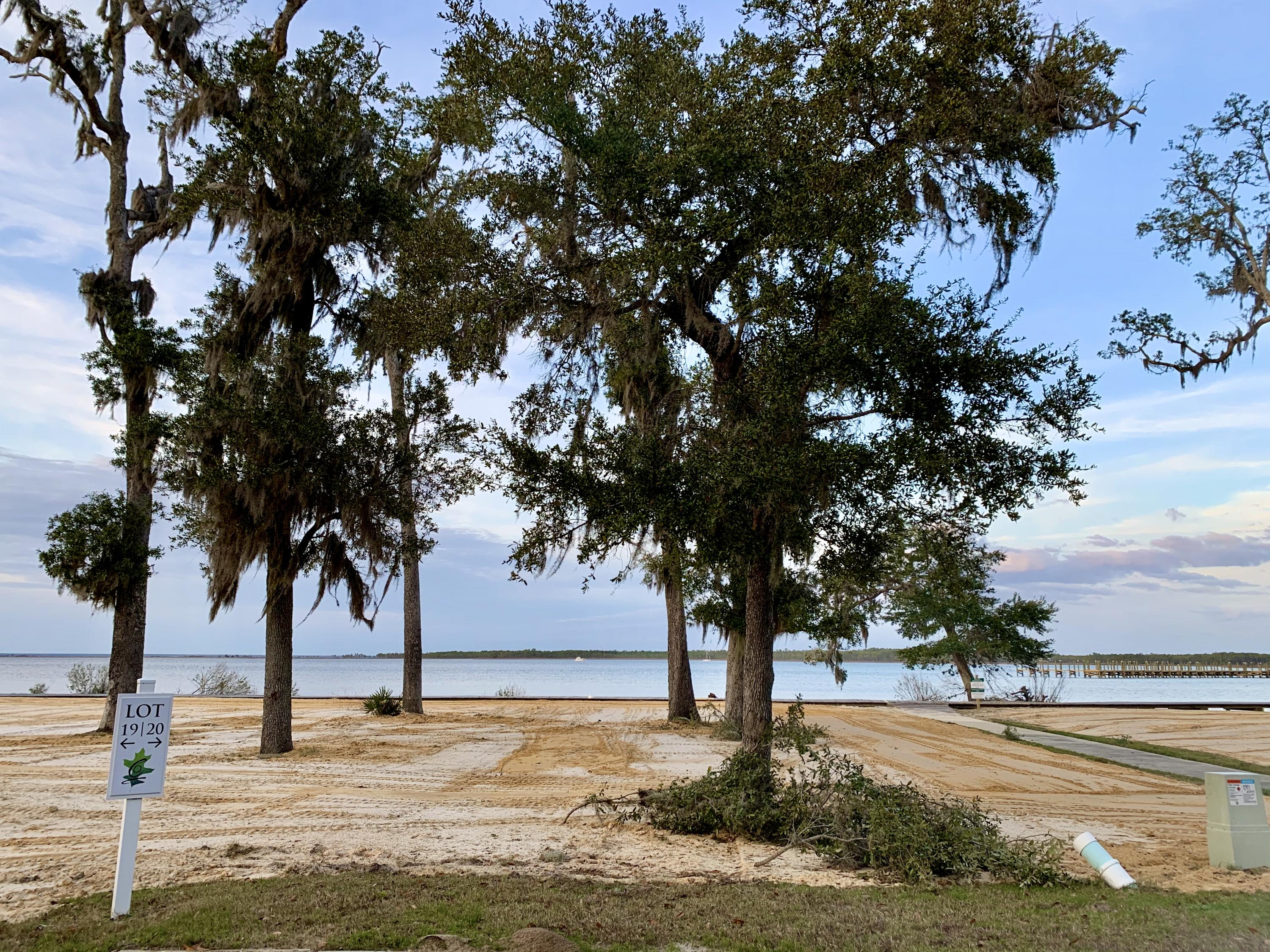 Lot 19 is a premium bay front homesite situated on a quiet cul-de-sac and tucked away with only nati