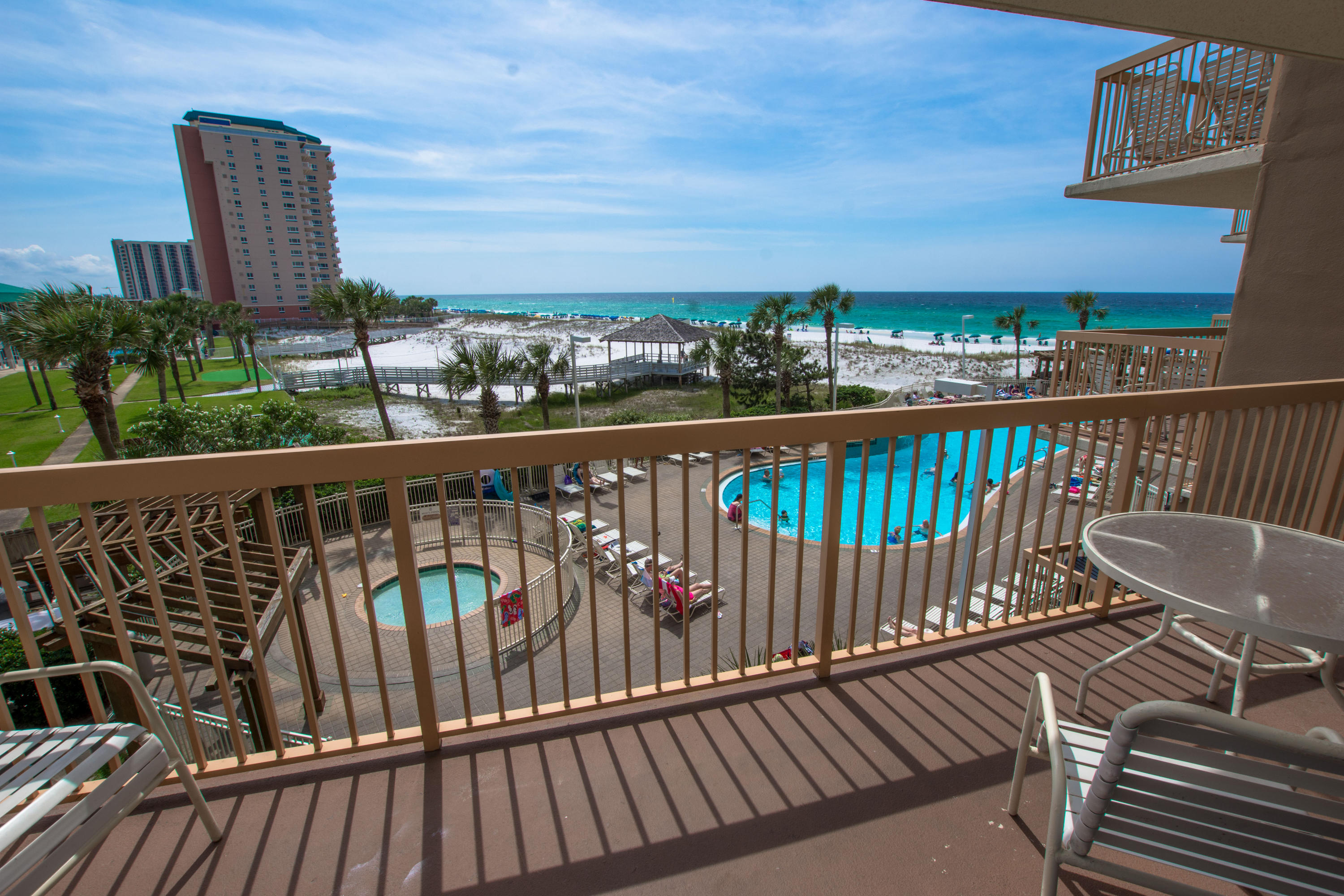 Rental powerhouse in the popular Pelican Beach Resort with a toes-in-the-sand GULF FRONT location on