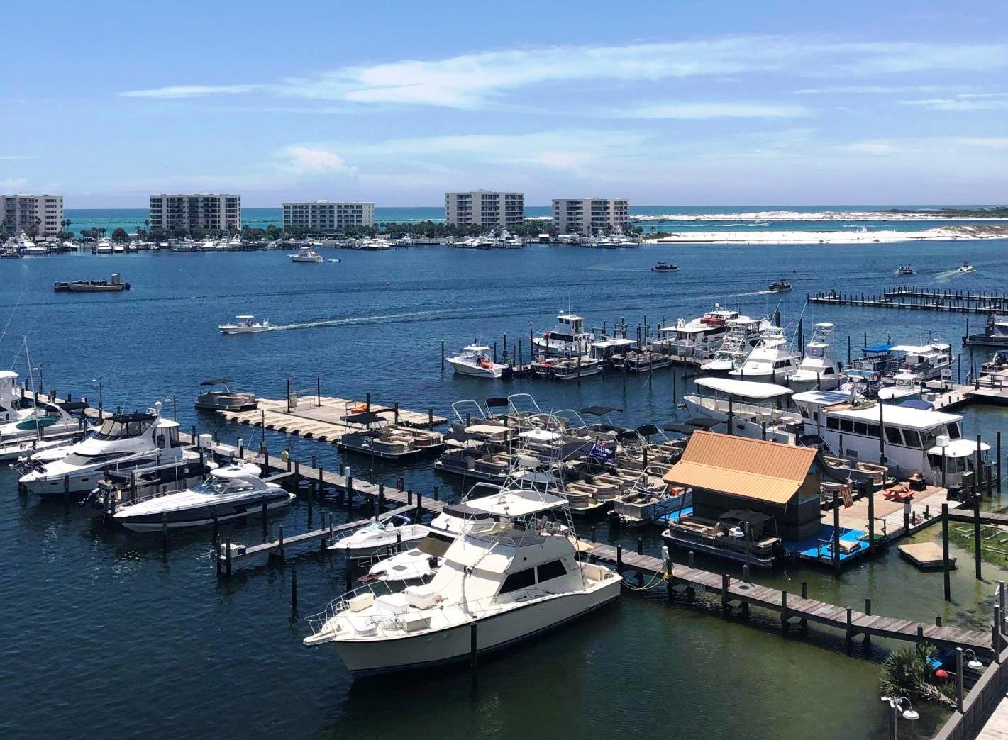 Enjoy harbor living at its finest in this fifth floor unit overlooking Destin harbor, the East Pass