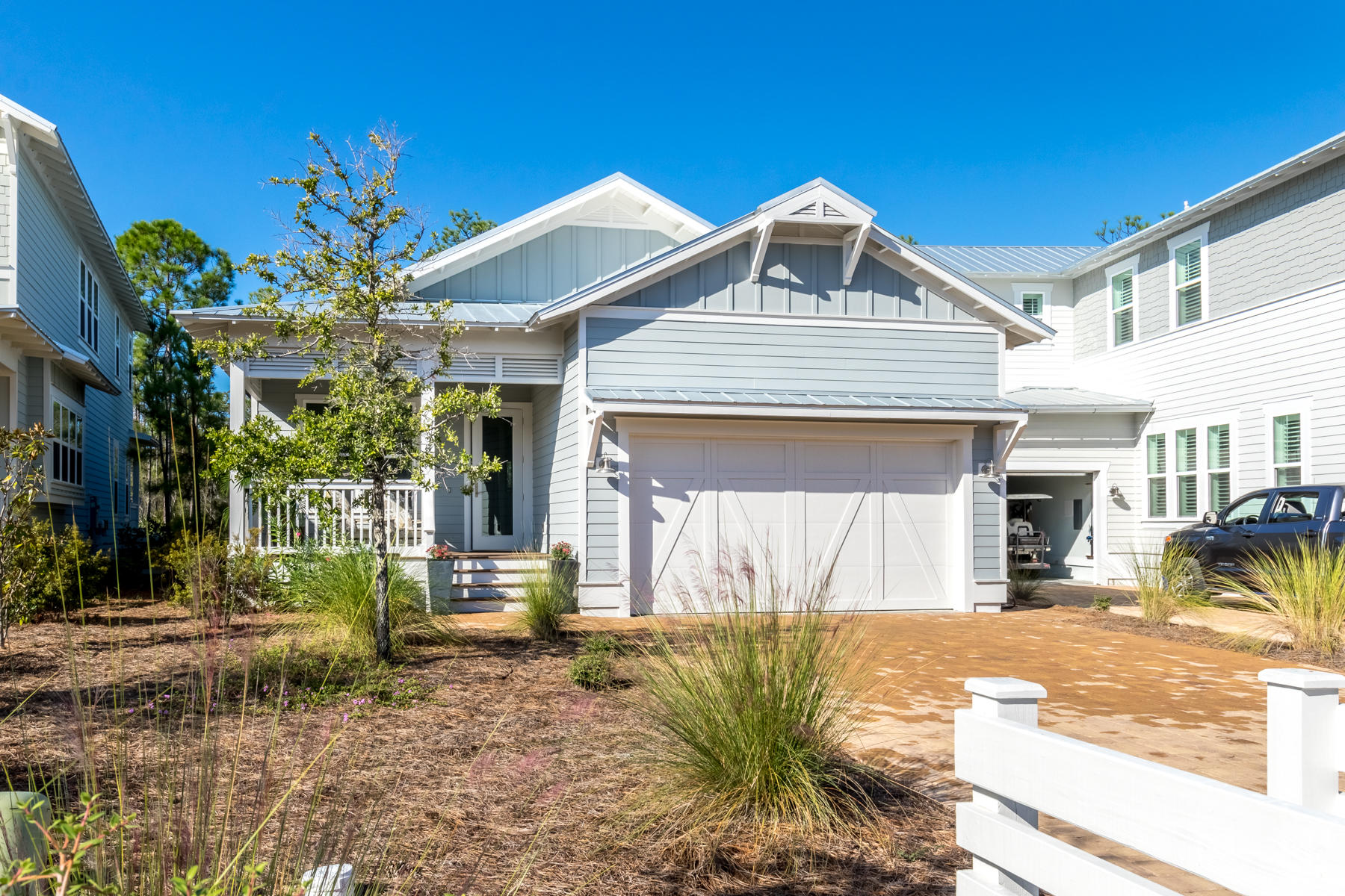This rare SINGLE STORY cottage offers 3 spacious bedrooms, 2 CAR GARAGE, open concept living and top
