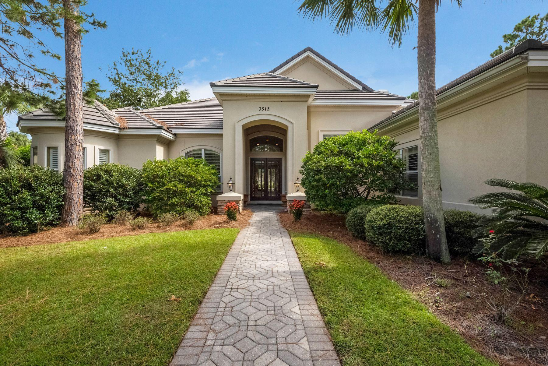 This lakefront estate in the prestigious gated neighborhood of Burnt Pine offers open architecture w