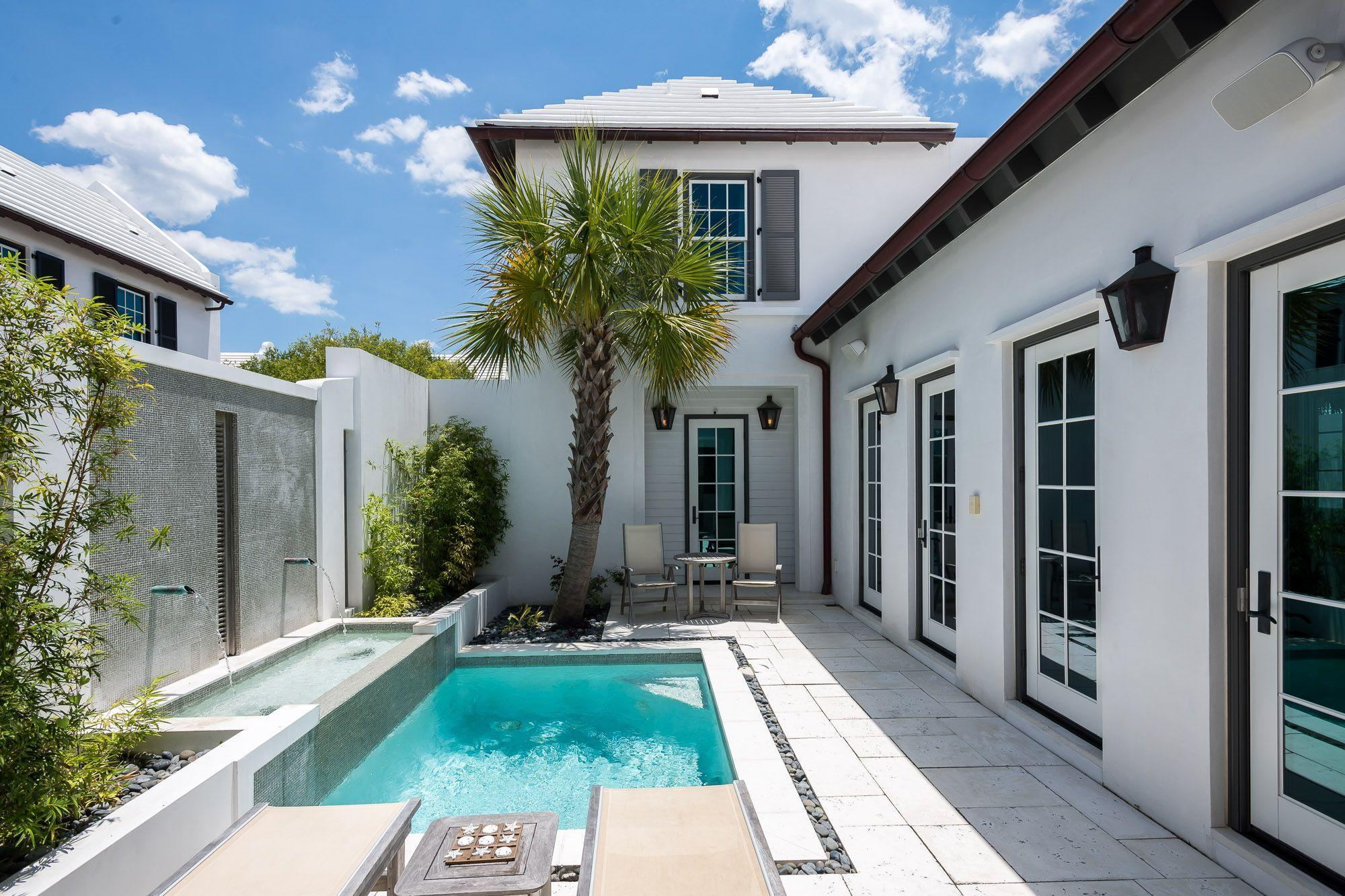 This four-bedroom Bermuda inspired freestanding home is ideally located on the iconic Charles Street