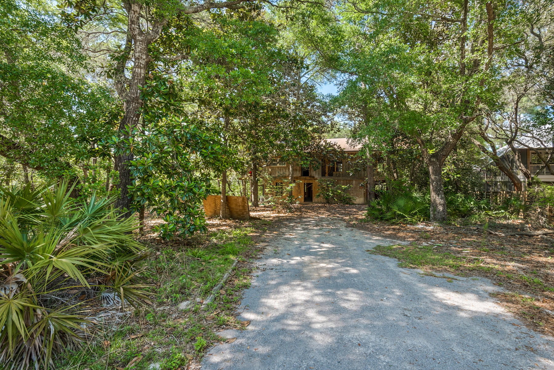 Tucked away among the trees in Old Seagrove and located  just 4 blocks from Seaside and the public b