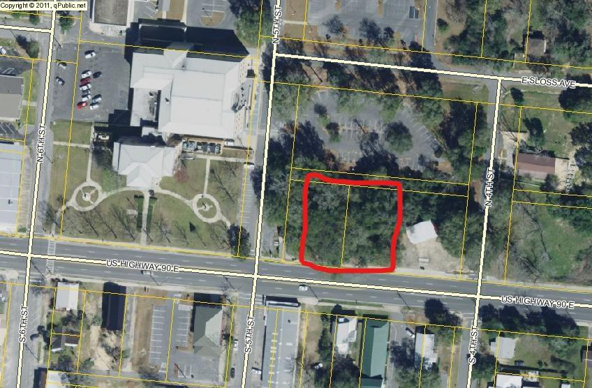 Highway 90 frontage within very close proximity of Walton County Courthouse. It is on north side of Highway 90, same as courthouse. C1 already. Abuts courthouse park lot.