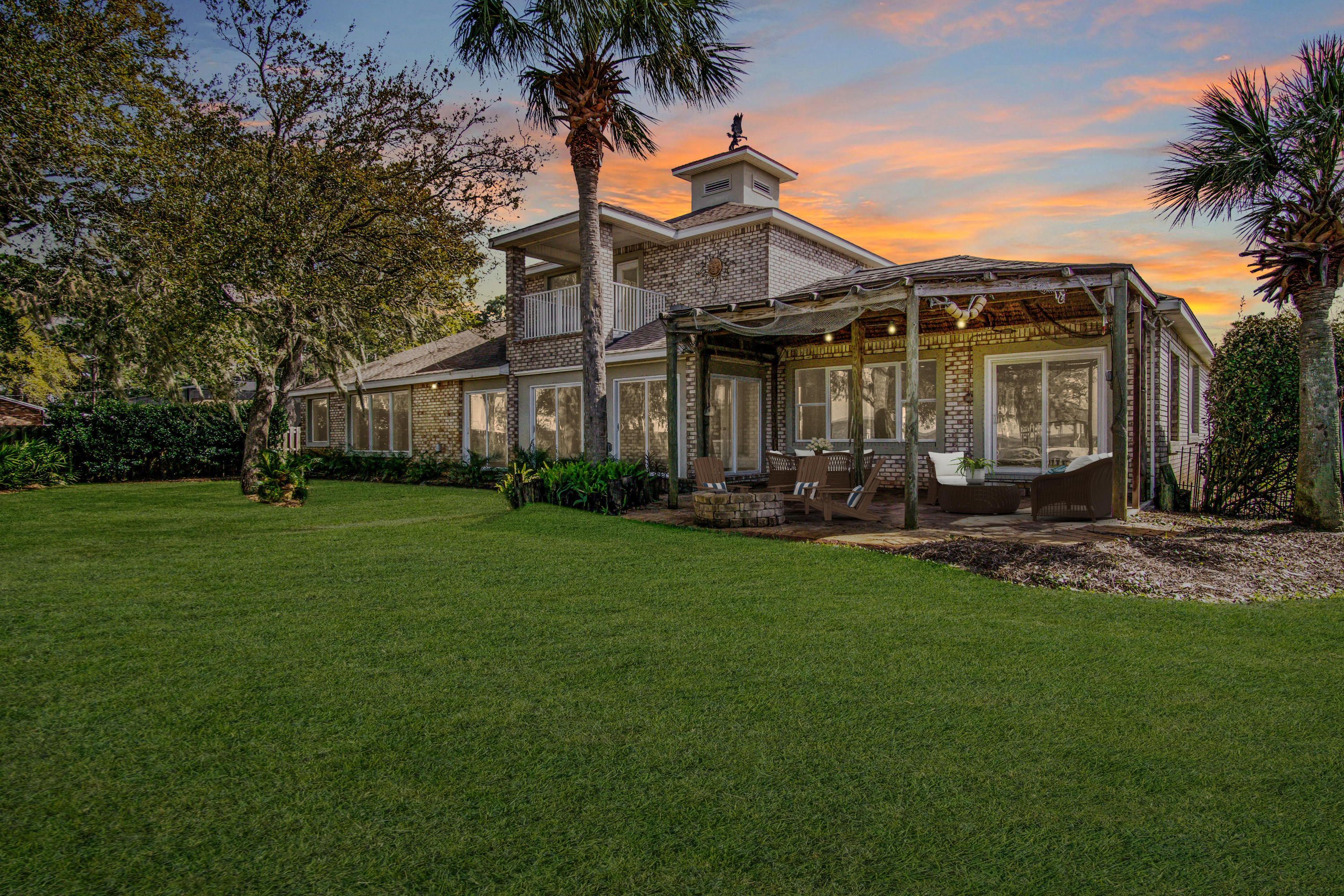 This immaculate, spacious home with majestic oaks dressed in Spanish moss with a gorgeous waterfront