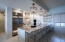 Kitchen and Breakfast Bar featuring Marble Countertops