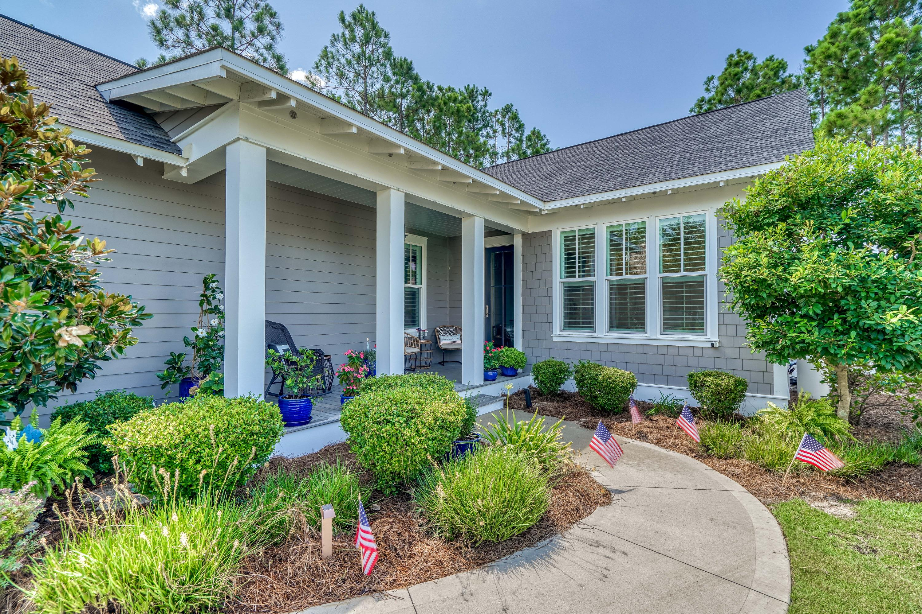 Immaculate home in WaterSound Origins. Located on a premium corner lot with a picturesque gas lanter