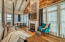 Carriage House Living Area with Custom Built Wood Mantle made from Pecky Cypress and Mahognay