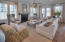 Photos depict another home with the same floor plan