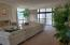 Open floor plan flows from hall to living, and dining all with views.