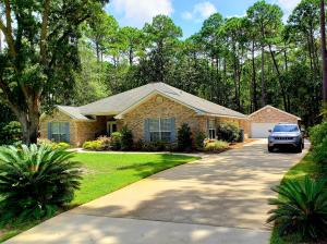 Large lot, long driveway, and detached garage allows for plenty of parking