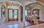 BUILDERS SIGNATURE DOUBLE DOOR WITH GLASS, TRANSOM WINDOW, ARCHWAYS, 21' CEILING....CREATING SPACIOUS OPEN AREA DESIGNED FOR ENTERTAINING.
