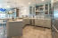 Expansive kitchen with crystal quarts countertops