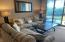 Living area w/sofabed and loveseat. Neutral color pallete.