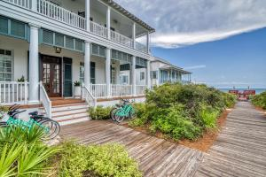 A hard wood boardwalk adjacent to the home is the only thing separating you from the GLIMMERING WATERS OF THE GULF.
